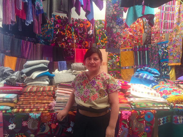 A Tzotzil Mayan woman selling her traditional textiles in Zinacantán (photo by Cayte Bosler).