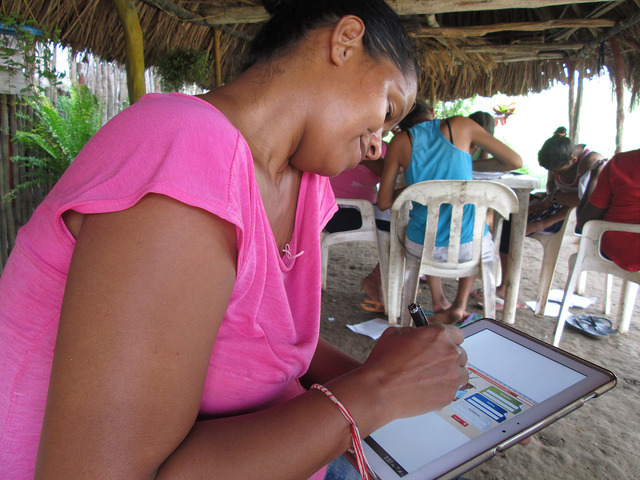 A Graduation entrepreneur in Colombia with an early version of the app.
