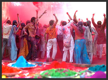 Indian revelers  celebrate Holi by throwing powdered dye